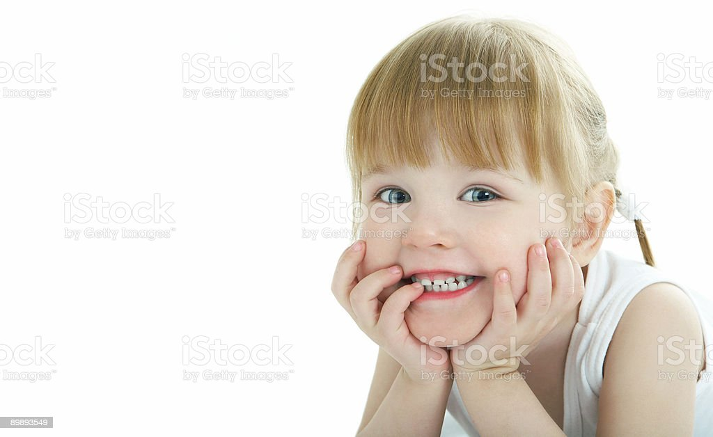 Female toddler grinning with her head in her hands royalty-free stock photo