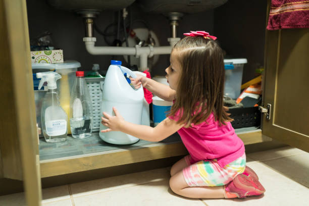 female toddler in kitchen at home - poisonous stock pictures, royalty-free photos & images