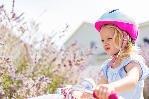 Female Toddler Riding a Bicycle