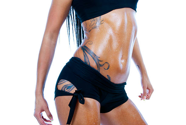 Female toned body with tattoo. stock photo