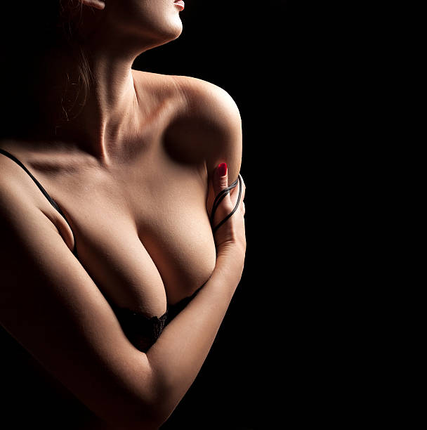 female torso with bra on black background - body parts of sexy girls stock pictures, royalty-free photos & images