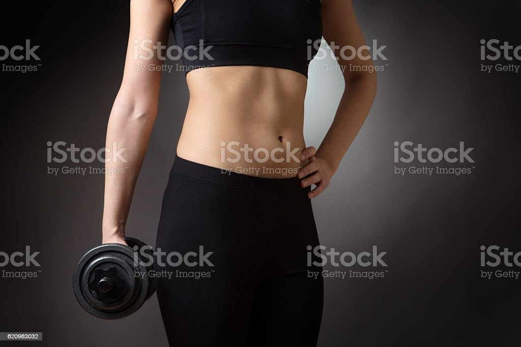 female torso with dumbell foto royalty-free