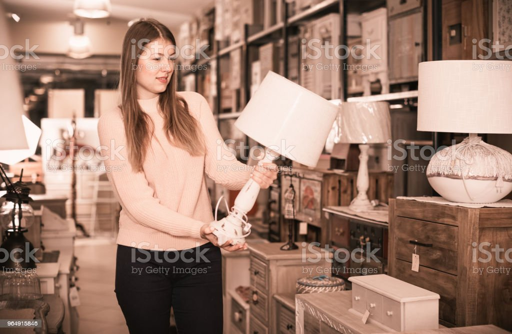 female touching torchere in the furniture store royalty-free stock photo