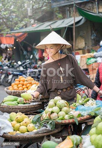 istock Female Tourist at the local Fruit Market, Hanoi, Vietnam 685301090