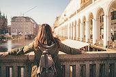 Young, woman, tourist, enjoying a view from the bridge, wearing a sunglasses. Jungfernstieg, Hamburg, Germany.