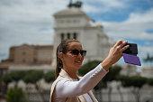 Female tourist in Rome, making selfie at piazza Venezia, enjoying her city break, Nikon Z7