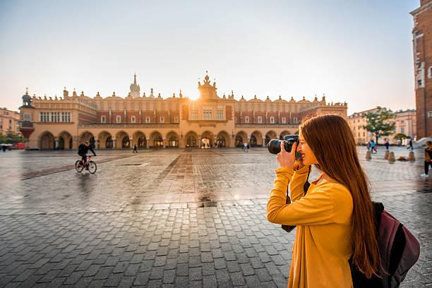 Female tourist in the center of Krakow stock photo