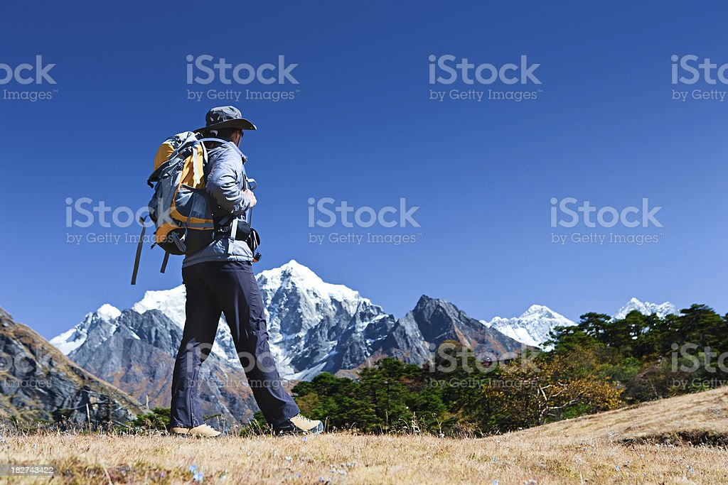 Female tourist is looking over Himalayas royalty-free stock photo