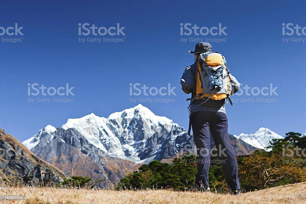 Female tourist is lookinh over Himalayas  in Mount Everest Natio stock photo