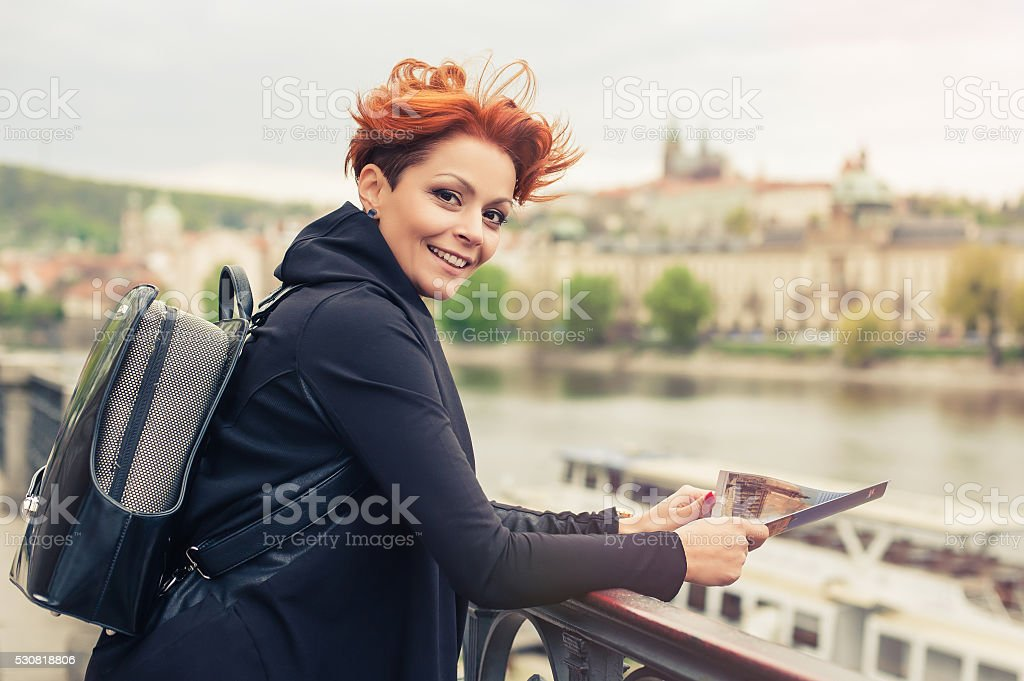 Female tourist looking at city guide stock photo