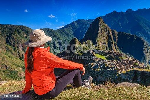 istock Female tourist looking at Machu Picchu 1284550601