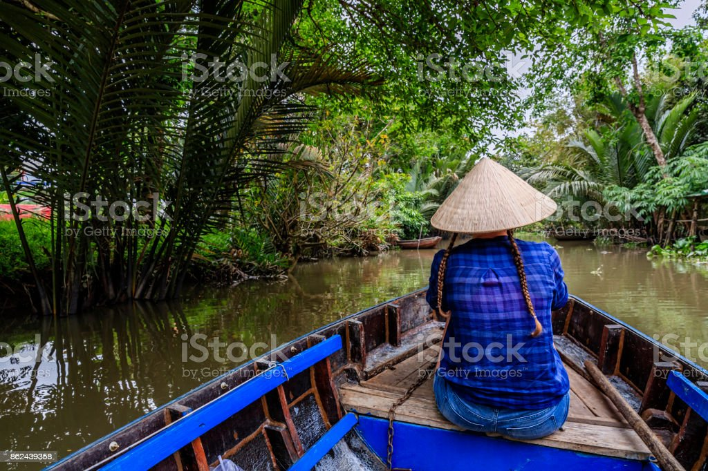 Female tourist on boat in Mekong River Delta, Vietnam stock photo