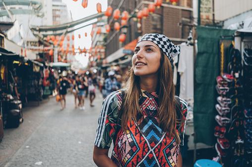 Female tourist on the old market street