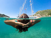 DCIM\\101GOPRO\\G1973019.Female tourist on the yacht swims.