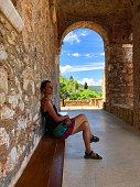 Woman taking a rest from visiting the Pantanassa Monastery (Greek: Μονή Παντανάσσης) Mystras or Mistras (Greek: Μυστρᾶς/Μιστρᾶς), Peloponnese or Peloponnisos, Greece
