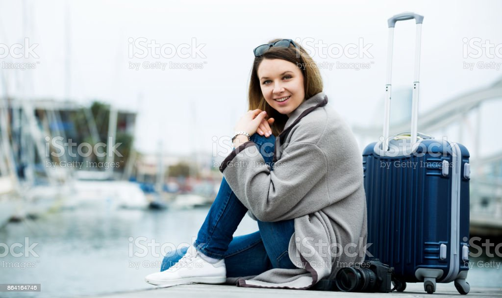 Female tourist standing at pier royalty-free stock photo