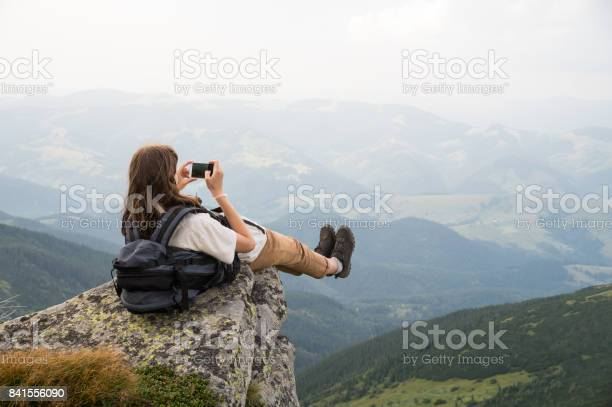 Female tourist takes photo of legs with cell phone from top of the picture id841556090?b=1&k=6&m=841556090&s=612x612&h=lialo1 jdewsthnut2hbnhl bdosx8fsxsy9686fvsk=
