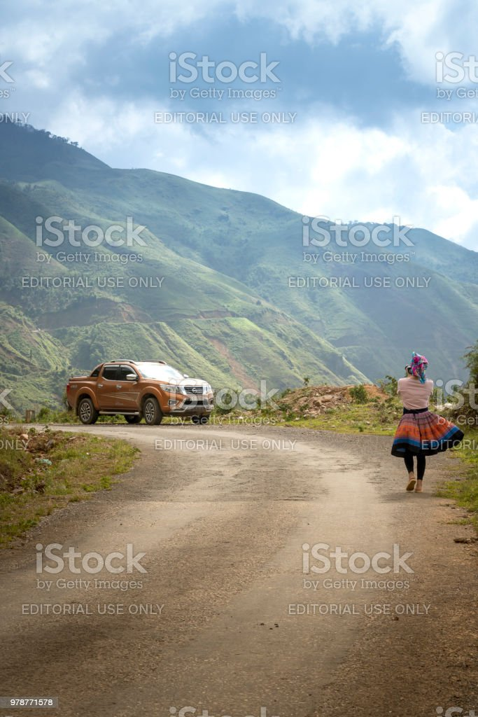 female tourist to experience the life of ethnic minority H'Mong in Ta Xua commune, Son La province, Vietnam stock photo