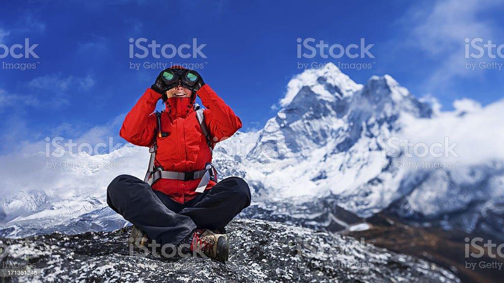 Female tourist using binoculars, Mount Everest National Park royalty-free stock photo