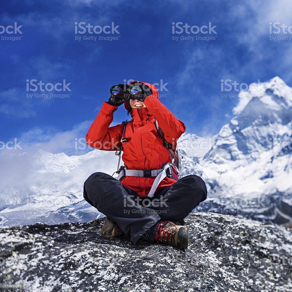 Female tourist using binoculars, royalty-free stock photo
