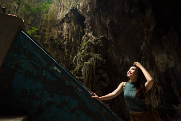 Female tourist visiting the Batu Caves near Kuala Lumpur, Malaysia Tourist visiting Batu Caves in Kuala Lumpur, Malaysia kuala lumpur batu caves stock pictures, royalty-free photos & images