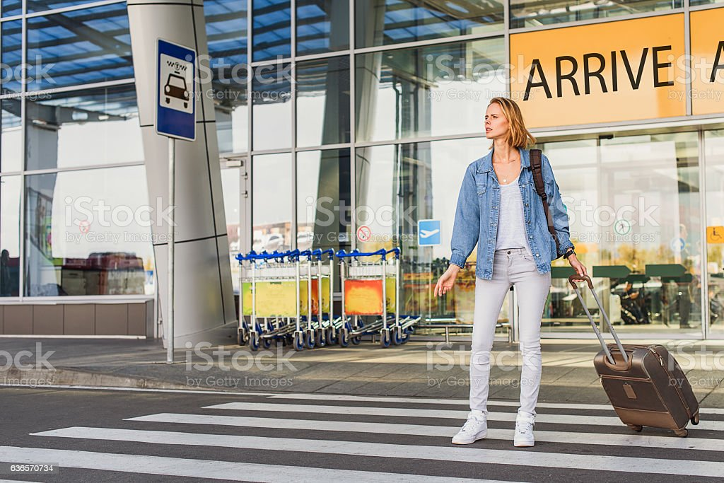Female tourist waits for transport stock photo