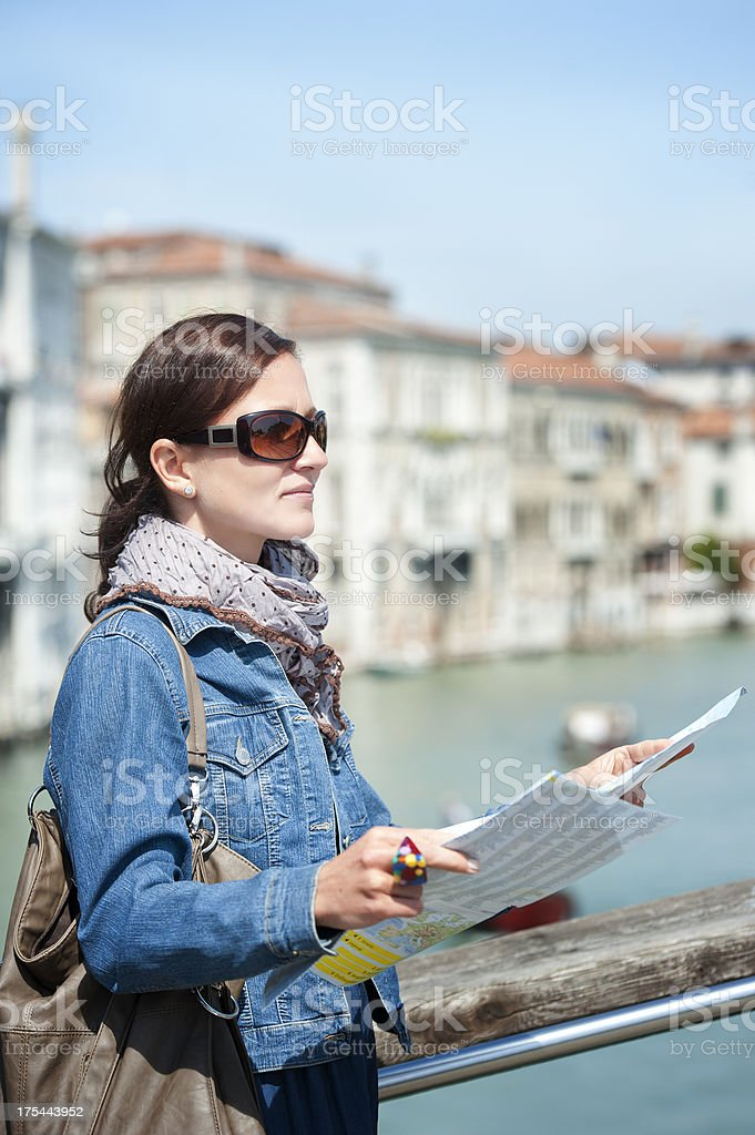 Female tourist with city map in historic town, Italy royalty-free stock photo