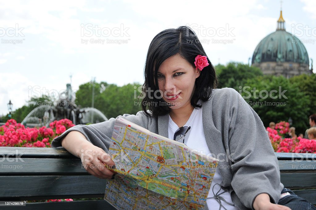 female tourist with city map on Alexanderplatz Berlin Mitte (Germany) royalty-free stock photo