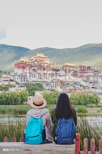 istock Female tourists are traveling in Little Potala Palace Lamasery