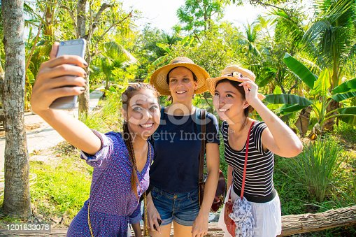 Female tourists taking selfie at a plantation