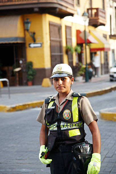 female traffic policewoman on duty in lima city centre - peruvian ethnicity stock pictures, royalty-free photos & images