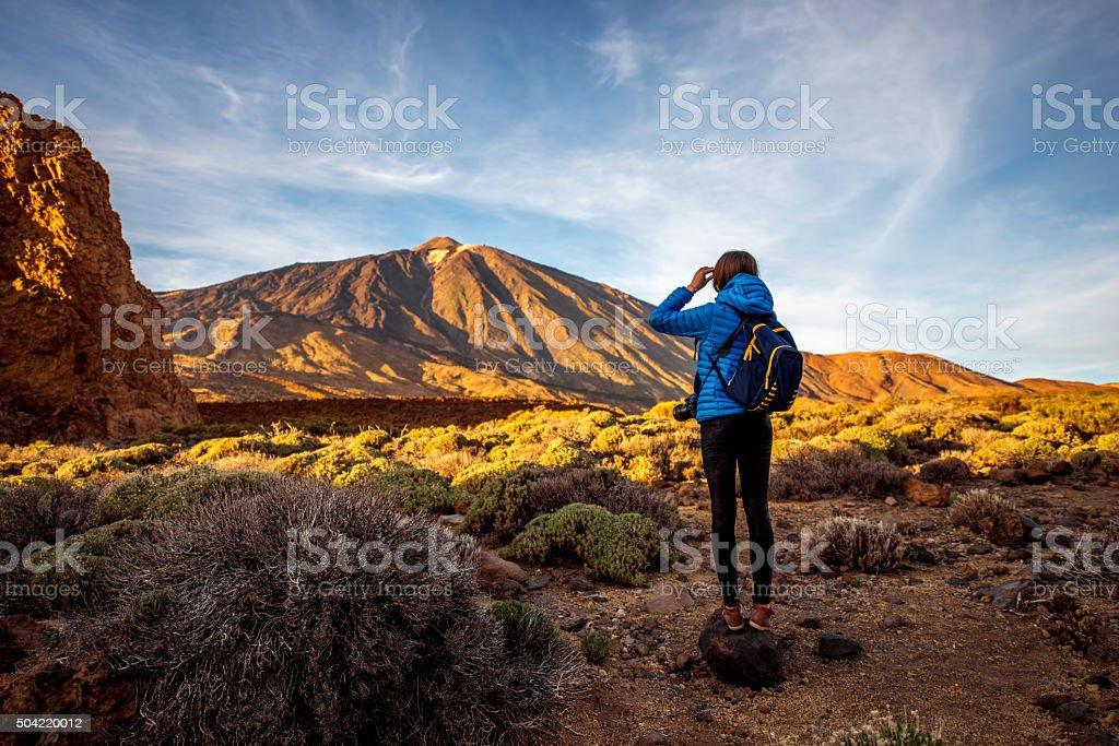 Female traveler in Teide park stock photo