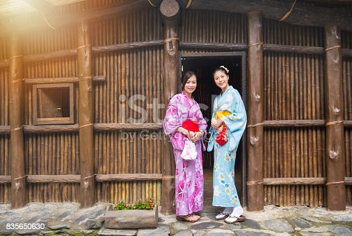 istock female travelers wearing traditional clothing 835650630