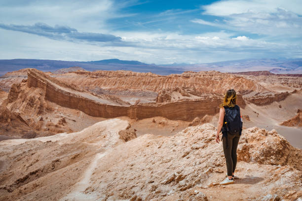 Female Traveller Exploring the Valley of the Moon in the Atacama Desert, Chile, South America stock photo