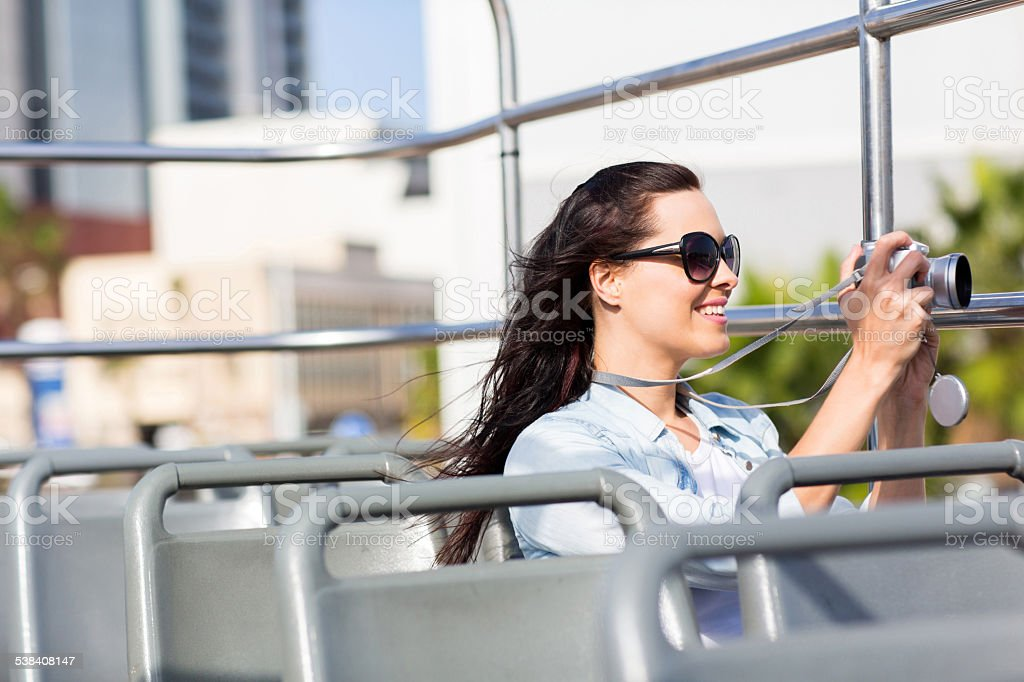 female traveller taking video of the city stock photo