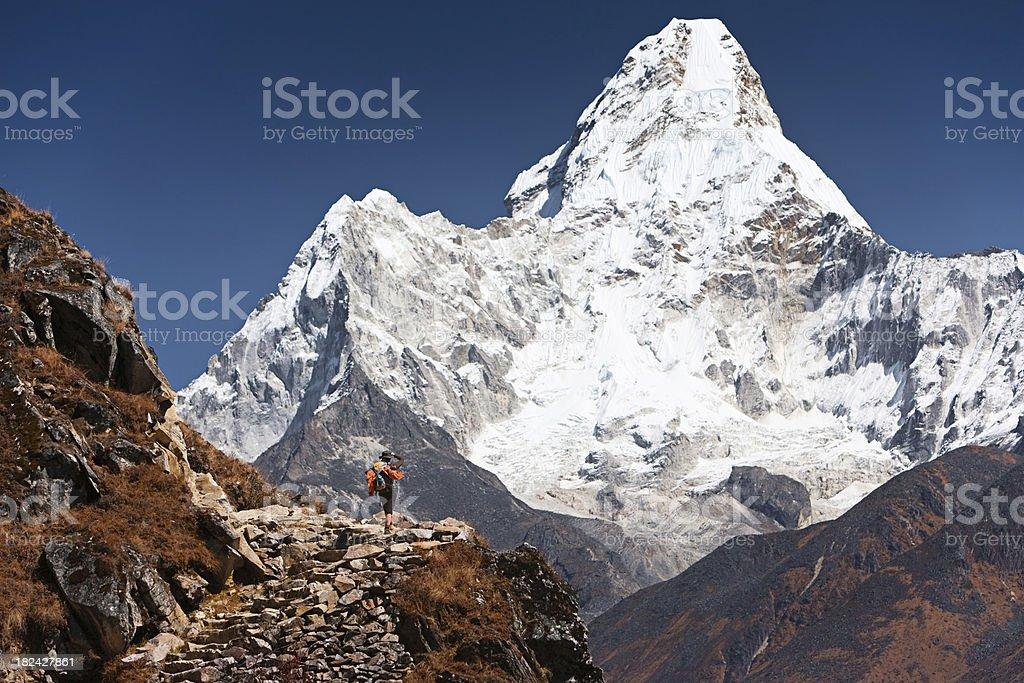 Female trekker looking at Ama Dablam stock photo