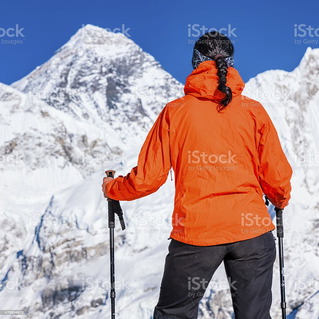 Female trekker looking at Mount Everest, Himalayas, Nepal royalty-free stock photo