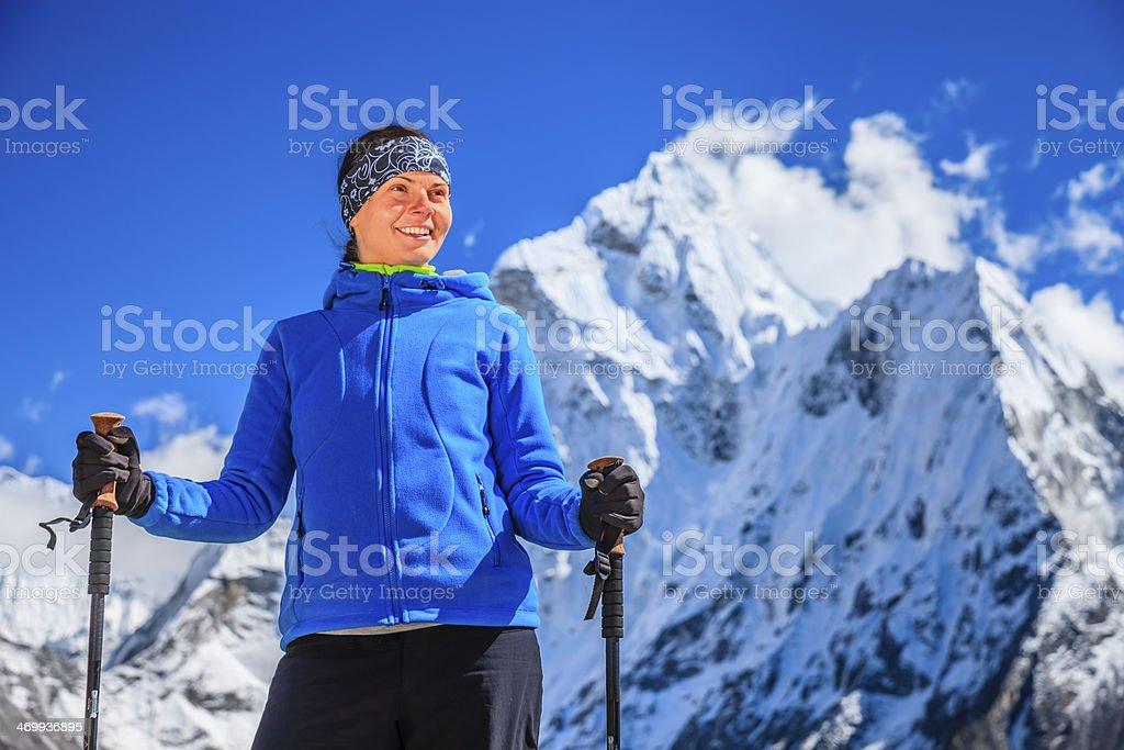 Female trekker looking over Himalayas, Mount Everest National Park royalty-free stock photo