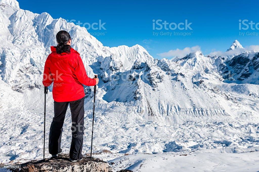 Female trekker looking over Himalayas, Mount Everest National Park stock photo