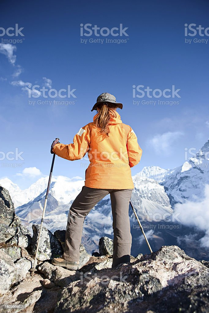 Female trekker looking over Himalayas royalty-free stock photo