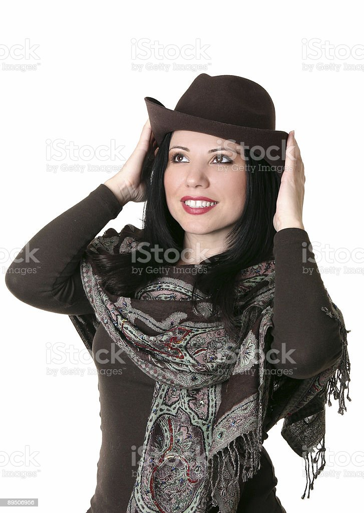 Female trying on a brown felt hat royalty-free stock photo