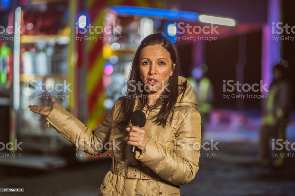 Female TV reporter stock photo