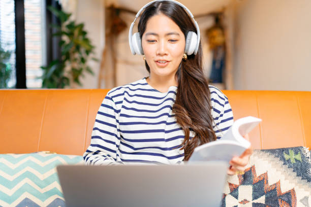 Female university student studying from home stock photo