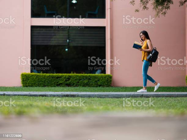 Female university student walking and reading a book picture id1161222699?b=1&k=6&m=1161222699&s=612x612&h=wbhei8ys   gml5leagnpn97jyskvkznrvj5bcgz1xm=