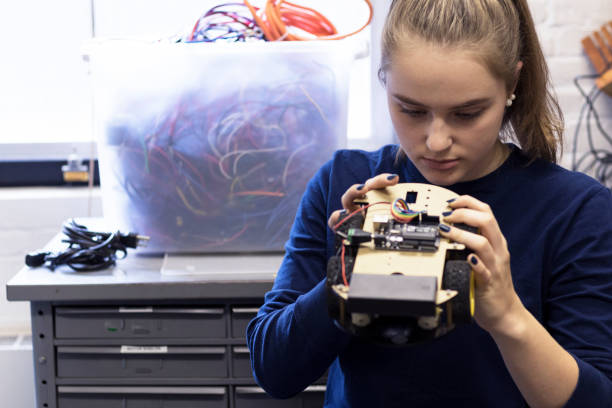 female university student working on her new project at the lab - physics stock photos and pictures