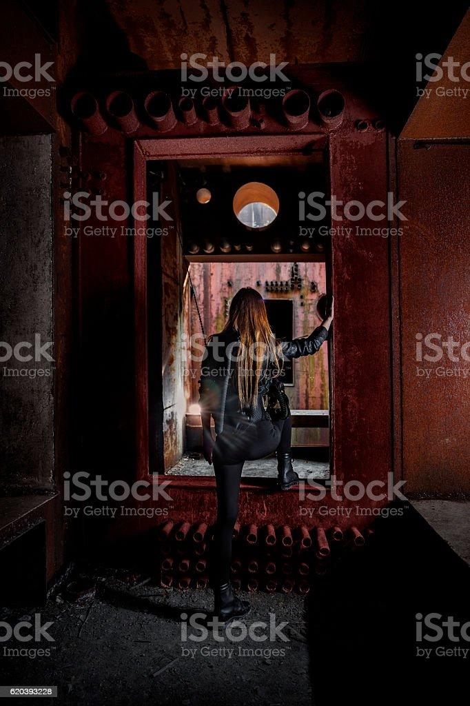 Female urban explorer in abandonned military bunker stock photo