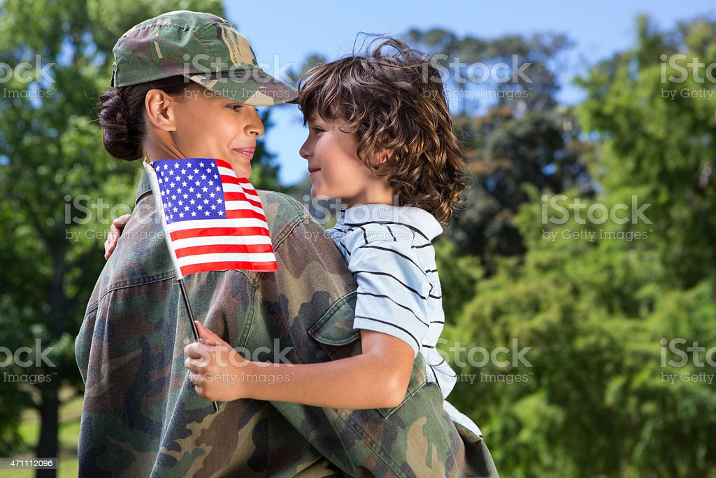 A female US soldier reuniting with her happy son stock photo