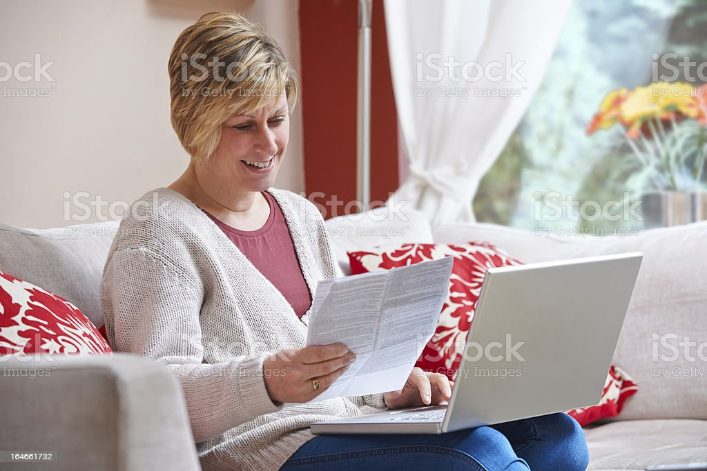 A female using a online banking service royalty-free stock photo