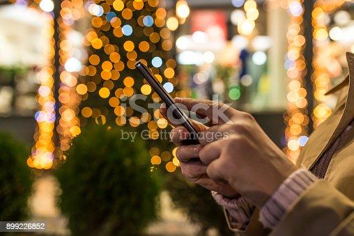 istock Female using her mobile phone 899226852