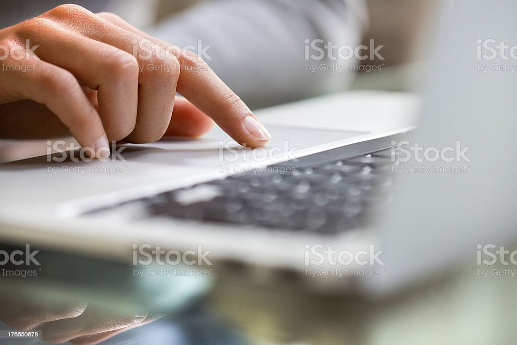 Female using keyboard computer indoor.close-up stock photo